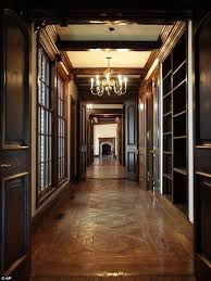 enlarge a hallway lined with windows leads away from the master bedroom of the main house