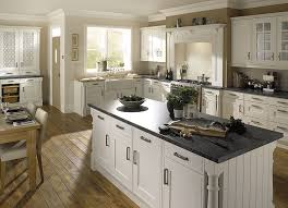 traditional kitchens white units with black work tops