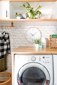laundry room makeover white subway tile charcoal grout vintage revivals
