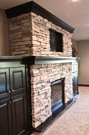 wood mantle stone fireplace built ins around fireplace tv above fireplace