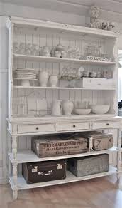 Kitchen vintage storage hutch ~ French country, rustic farmhouse style -  LOVE the trunks for above kitchen cabinets