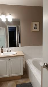 before photo of a small dated bathroom being renovated using ikea veddinge cabinets