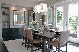 gorgeous modern dining room chandelier over grey set in with large windows and painting decor chandeliers for living elegant ceiling fans crystals diy