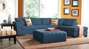 orange and blue living room ideas living room set blue tufted sectional with orange blue and white striped pillows square blue tufted ottoman blue and