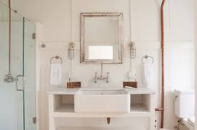 exciting nautical wall sconce beachy candle wall sconces mirror and hanging sconces lamp beside and sink faucet and glass shower and towel and toilet