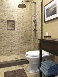 bath ideas: contemporary bathroom with doorless walk in shower also mosaic wall tiling also classic shower head design also white classic toilet also brown classic