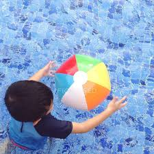 beach ball in pool. Boy Playing With Colorful Beach Ball In Swimming Pool \u2014 Stock Photo