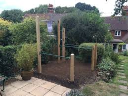 building a backyard pull up bar al kavadlo backyard gym cement dining table theradmommy com