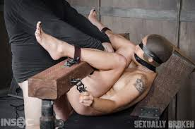 Milcah Halili is bound hooded gagged blindfolded and brutally.