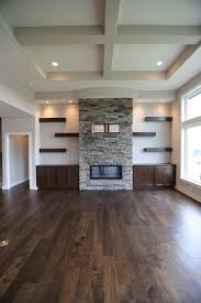 stone fireplace gas log fireplace floating shelves and cabinets on both sides arranged floating shelves maybe around tv