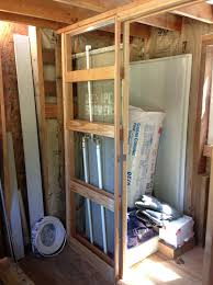 tiny house plumbing. Tiny House Style Shoeboxhaus My Dad Working On The Bathroom Shower Plumbing And Pocket Door Frame In Y