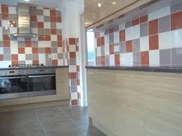 kitchen wall tiles white orange and grey