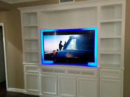white tv entertainment center. White Entertainment Center With TV Over Fireplace · Tv Stand Bookshelves