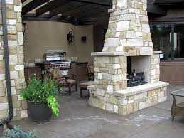 delightful indoor outdoor double sided wood burning fireplace