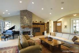 its white walls and light wood flooring do not offer contrast the colors change with the gray fireplace stones and