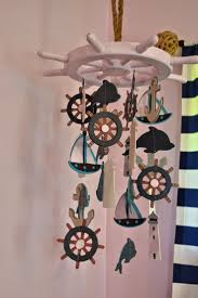 Have got to make something like this for his nursery! Manic Mama Miles:  Nautical Nursery DIY Baby Mobile Maybe not a mobile but wall hangings