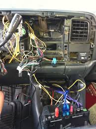 my double din conversion complete 99 silverado after this then its just a regular install double din dash kit wiring harness but the parking brake bypass was fairly easy all you need is a 12v relay