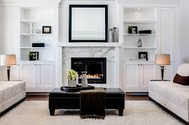 fireplace built ins living room transitional with lamps contemporary ottomans and footstools