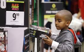 a boy looks over a black friday item at a j c penney friday nov 24 2017 in seattle black friday has morphed from a single day when people