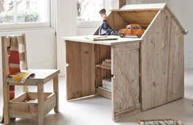 beautiful reclaimed wood desk for kids is also a playhouse easel inhabitots