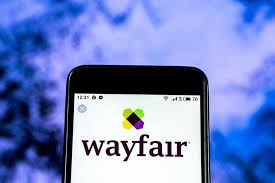 cell phone with wayfair logo on the screen wayfair s return costs are