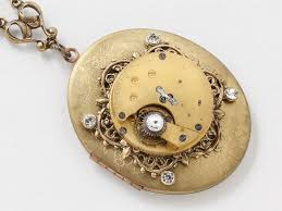 steampunk locket necklace gold pocket watch movement with victorian filigree bezel and crystal stones large oval locket