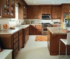 cherry kitchen cabinets traditional kitchen with cherry cabinets by cabinetry cherry kitchen cabinets with black granite cherry kitchen cabinets