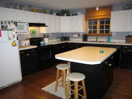 Painted black and white bi color kitchen cabinets satin brass