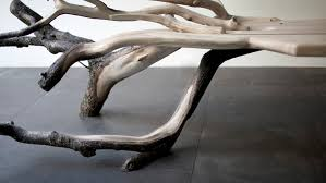 The jointing of the tree branches to the bench is almost invisible and the  use of branches with bark still attached really adds to the story.