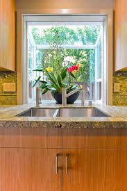 Lovely Bay window for small kitchen with sink; Inspiring kitchen bay windows  over sink with vase flower