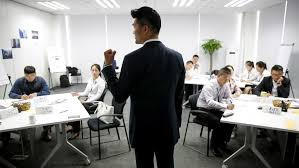 the steps you need to take before asking for a promotion quartz trainer lee yida gives a lecture to dealership s staffs during a s camp at bmw