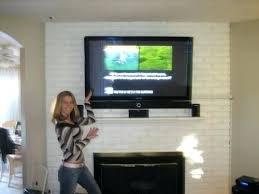 how high to hang tv awesome hanging over fireplace design for mounting a over a fireplace how high to hang tv hanging over fireplace