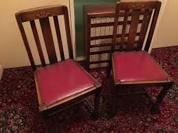set of 4 vintage dark wood dining chairs with red leather seat