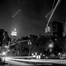 empire state building black and white. black and white artwork featuring the empire state building at night