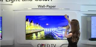 lg oled wallpaper tv. at a tech convention in seoul, lg unveiled their new model of oled television. unlike standard tvs on the market currently, this one bends. lg oled wallpaper tv
