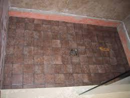 tile shower walls or floor first