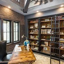 office industrial. Inspiration For A Mid-sized Industrial Freestanding Desk Dark Wood Floor And Brown Study Office