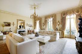 Living Room:Unusual Victorian Style Living Room With Gold Chandelier And  Long White Leather Sofa