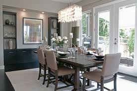most popular dining room chandelier with large rugs under table also using square wall mirror