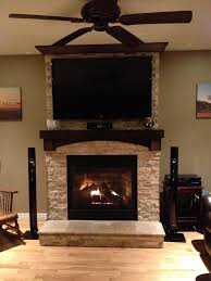 stone on fireplace with tv mounted over mantle i like the mantel but do not