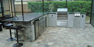 dryvit with stacked stone outdoor kitchen featuring a memphis wood pellet grill side burner refrigerator and doors drawers for storage