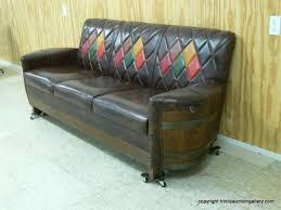 whiskey barrel couch vintage whiskey barrel sofa naugahyde