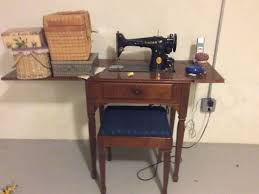 vine singer sewing machine with cabinet and bench 0