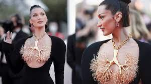 Bella Hadid wears golden lung necklace ...