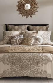 S- Taupe and gold bedding set. http://www.beddingworld.