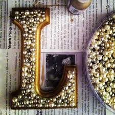wooden letters with pearls glued on
