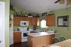 kitchen light green kitchen wall color and oak wood cabinet with white countertops gray