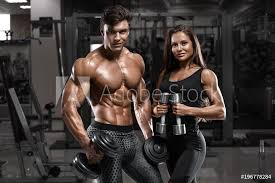 Fotografie Obraz Sporty Sexy Couple Showing Muscle And Workout In