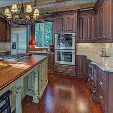 Paying inside home furnishings for your 1st dwelling, or wherever you don't expect toward live permanently, can approximately seem to be like a waste. Dark Wood Cabinets With Light Wood Floors Kitchen Interior Design Nj Pa