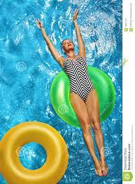 pool water with float. Woman Sunbathing, Floating In Swimming Pool Water Stock Image - With Float